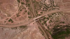Aerial high shot of cars on dry desert road Stock Footage