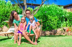 Young family of four on vacation Stock Photos
