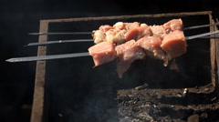 Cooking meat on a grill Stock Footage