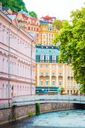 Colorful hotels and traditional buildings on sunny town of Karlovy Vary. The - stock photo