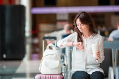 Airline passenger in an airport lounge waiting for flight aircraft. Caucasian - stock photo