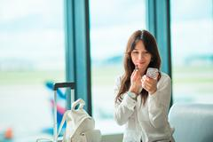 Airline passenger in an airport lounge waiting for flight aircraft and coloring Stock Photos
