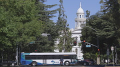 Pickup truck drives toward historic courthouse Stock Footage