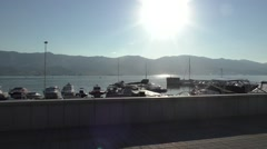 Boat Station, Sun Shining in Centre of Camera, Mountains Are on Background Stock Footage