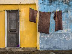 Laundry hanging in front of the people home in poor neighbourhood in Ponta Delga Stock Photos