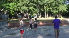 Three Girl and Man Are Strolling in Park in Day of Summer, Posing Around a Stock Footage