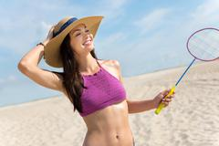 Cheerful smiling woman playing badminton Stock Photos
