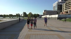 Teens Walking on Sunny Pedestrian Road in Summer Vacation Stock Footage