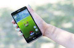 Pokemon Go game in a hand. Krabby Stock Photos