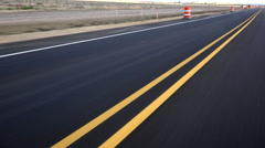 4K Drive Past Road Construction Barrels  Freshly Painted Bright Yellow Lines Stock Footage