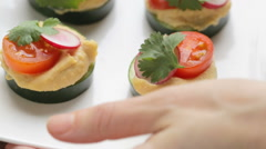 Hummus and Cucumber Appetizers Stock Footage