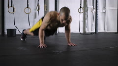 Burpees and deadlift young athlete doing intense gym workout Stock Footage