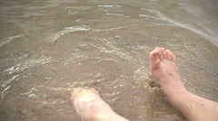 Close up slow motion kicking of a child splashing in the river Stock Footage