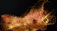 Liquid Splash. Alcohol, Tea, Cola. Super Slow motion. Stock Footage
