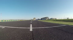 FPV LOW ANGLE: Racecar driving fast competing on racetrack on sunny day - stock footage