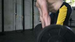 Closeup of young athlete doing deadlift barbell exercise Stock Footage