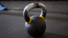 Closeup of kettlebell weight at gym taken by athlete Stock Footage
