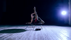 Flexible woman doing contortion on stage Stock Footage