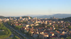 AERIAL: Flying above the homes and houses towards the majestic city castle Stock Footage