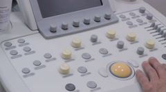 Keyboard ultrasound device close up, doctor's hand presses buttons Stock Footage