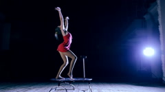 Flexible woman doing contortion while hand stand on stage Stock Footage