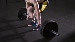 Closeup of young man doing deadlift workout at the gym Stock Footage