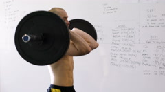 Hang power clean exercise - young man doing weight lifting workout at gym Stock Footage