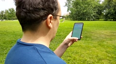 Pokemon Go application on the smartphone Stock Footage