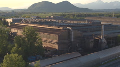 AERIAL: Industrial zone with warehouse manufacturing buildings and old factory Stock Footage