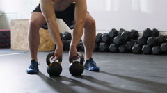 Kettlebell squats - young man doing functional workout at the gym - stock footage