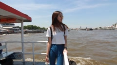 Thai chinese adult beautiful girl Denim blue bag travel boat tour in bangkok Stock Footage