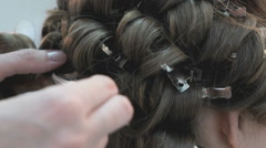 Master makes the curls to girl at the beauty salon - stock footage