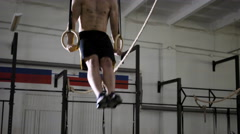 Young athlete doing muscle up exercise at the gym Stock Footage