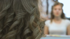 Master making hairstyle for bride at beauty salon - stock footage