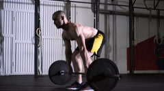 Young athlete getting ready and starting deadlift exercise at the gym Stock Footage