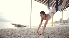 Anti-gravity Yoga, woman doing yoga exercises - stock footage