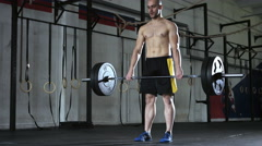 Young athletic man doing deadlift exercise at the gym. Stock Footage