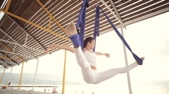 Anti-gravity Yoga, woman doing yoga exercises Stock Footage