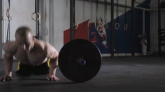 Young man during intense workout doing burpees over the bar Stock Footage