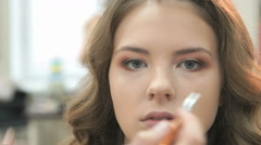 Professional makeup for the brown-haired bride Stock Footage