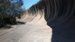 Wave rock wide angle gimbal shot Stock Footage