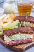 Classic reuben sandwich, served with dill pickle, potato chips, vertical Stock Photos