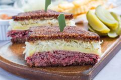 Classic reuben sandwich, served with dill pickle, potato chips, horizontal Stock Photos