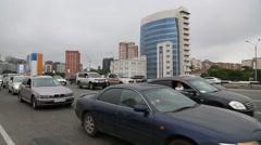 Car stream on the streets of Vladivostok, Russia Stock Footage