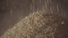 Corn kernels pour down into pile Stock Footage
