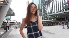 Thai chinese adult glasses beautiful girl Denim blue calling smart phone Stock Footage