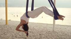 Anti-gravity Yoga, woman doing yoga exercises Stock Footage