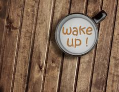 Cup of milk on wood table, with word wake up concept of breakfast Stock Photos