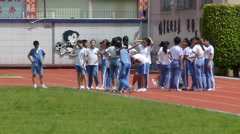 Shenzhen, China: primary school students in the physical activity class - stock footage