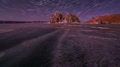 Starry night over the island Olkhon. Burkhan Cape, Olkhon island, Lake Baikal,  Stock Footage